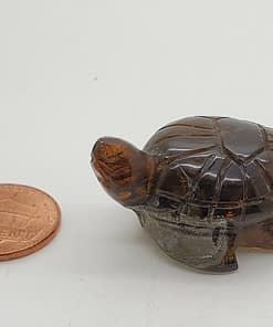 Turtle carving amber uv